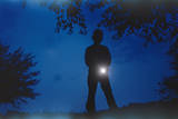 Silhouette of Boy Holding Flashlight Photographic Print by William P. Gottlieb