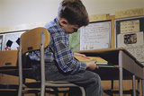 Schoolchild Placing Books in Desk Photographic Print by William P. Gottlieb