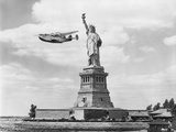 Seaplane Flying by Statue of Liberty Photographic Print by Edwin Levick