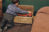 Boy Removing Fire Engine from Toy Chest Photographic Print by William P. Gottlieb
