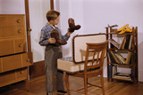 Boy Looking at Cowboy Boots Photographic Print by William Gottlieb