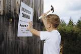 Boy Hammering Fair Sign Photographic Print by William P. Gottlieb