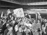 Yankee Fans Waving Pennants Photographic Print by Art Abfier