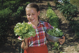 Girl Holding Head of Lettuce in Garden Photographic Print by William P. Gottlieb