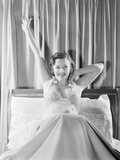 Woman Stretching in Bed Photographic Print by Philip Gendreau