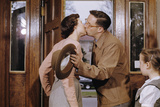 Husband and Wife Kissing Goodbye Photographic Print by William Gottlieb