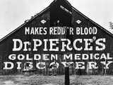 Patent Medicine Sign on A Barn Photographic Print by Dorothea Lange