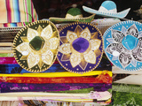 Sombreros and Serapes on Display in Market Photographic Print by Jack Hollingsworth