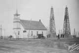 Oil Well Construction behind Church Photographic Print