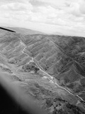 Burma Road Stretching across Landscape Photographic Print by Frank Cancellare