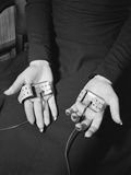 Pair of Hands Wearing Lie Detector Device Photographic Print by Sam Shere