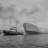 Towing the World Grandeur Ship Photographic Print