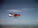 Cessna Skyhawk Flying Photographic Print