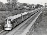 Denver Zephyr Train Going through Town Photographic Print by Philip Gendreau