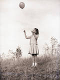 Girl Holding a Balloon Photographic Print by Philip Gendreau