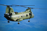 Military Helicopter Flying in Blue Skies Photographic Print