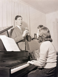 Boy and Girl Playing Instruments Photographic Print by Philip Gendreau