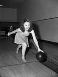 Young Woman Bowling Photographic Print by Philip Gendreau
