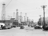 Clusters of Oil Derricks along Street Photographic Print by Philip Gendreau
