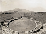 Amphitheater of Pompeii with Vesuvius in Background Photographic Print by Philip Gendreau