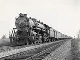 Locomotive Train Moving down Tracks Photographic Print