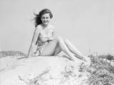Young Woman Seated on Sand Dune Photographic Print by Philip Gendreau