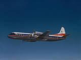Lockheed L-188 Electra Airplane in Flight Photographic Print