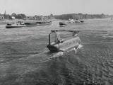 Helicopter Traveling on Water Photographic Print