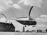 Helicopter Landing on Air Strip Photographic Print