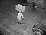 Delivery Boy Riding Bicycle with Box on Head Photographic Print