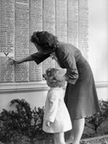 Woman and Daughter at Honor Roll Wall Photographic Print by Philip Gendreau