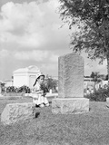 Girl Kneels at Headstone Photographic Print by Philip Gendreau