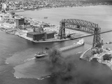 Cargo Boat Passing under Bridge Photographic Print by Charles Rotkin