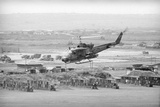 Helicopter Flying over Land Site Photographic Print