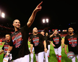 Kolten Wong, Adam Wainwright, & Matt Holliday celebrate winning Game 4 of the 2014 National League  Photo
