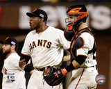 Santiago Casilla & Buster Posey celebrate winning Game 4 of the 2014 National League Division Serie Photo