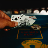 Hand Holding an Ace and Jack of Spades Cards Photographic Print by Philip Gendreau