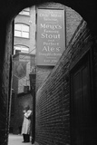 Man outside Ye Olde Mitre Tavern Photographic Print by Philip Gendreau