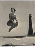 Woman Jumping in Front of Cape Florida Lighthouse, C.1975 Photographic Print