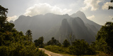 Laos, Vang Vieng. Dirt Road and Mountains Photographic Print by Matt Freedman