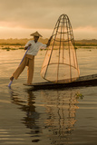 Sunrise. Intha Fisherman Rowing with His Legs. Inle Lake. Myanmar Photographic Print by Tom Norring