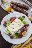 Greece, Peloponnese, Corinth, Greek Salad with Souvlaki and Fries Photographic Print by Walter Bibikow