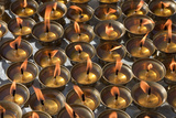 Bodhnath, Nepal. Candles Awaiting Worshippers at the Stupa Photographic Print by Charles Cecil
