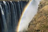Zimbabwe, Victoria, Rainbow over Victoria Falls Photographic Print by William Sutton