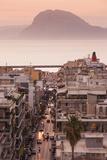 Greece, Peloponnese, Patra, City View over Agios Nikolaos Street, Dusk Fotografisk tryk af Walter Bibikow