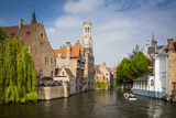 Tourist on Boat Ride Through the Canals of Bruges, Belgium Photographic Print by Brian Jannsen