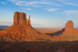 Mittens in Panoramic Landscape at Sunset, Monument Valley, Utah Photographic Print by Bill Bachmann