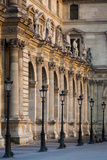 Lampposts Against the Architecture of Musee Du Louvre, Paris, France Photographic Print by Brian Jannsen