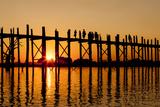 Sunset at U Bein Bridge. Pahtodawgyi Lake. Mandalay. Myanmar Photographic Print by Tom Norring
