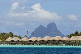 French Polynesia, Society Islands, Motu Tautau. Stilted Hotel Suites Photographic Print by Alida Latham